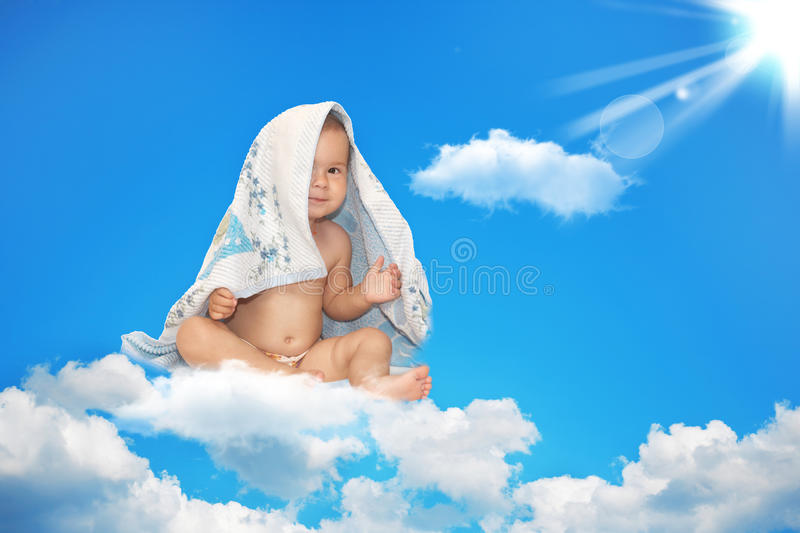 The Small Child Sits On A White Cloud Royalty Free Stock Photography