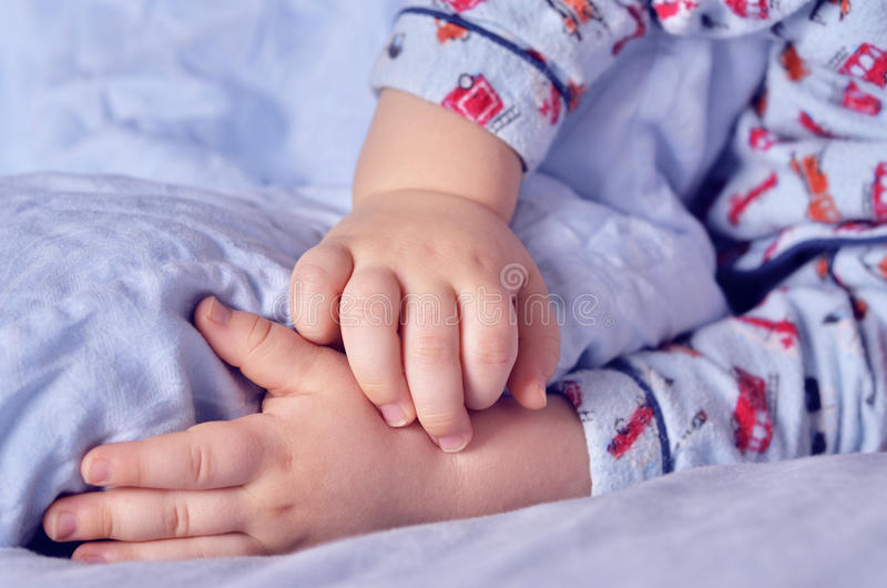 Small child sleeps stock image