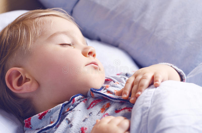 Small child sleeps stock images