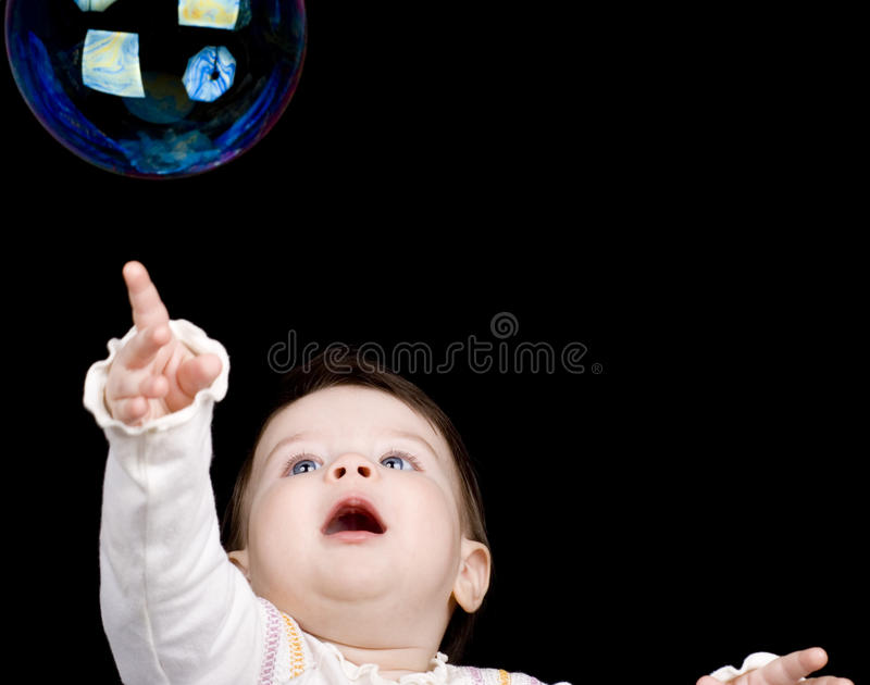 The small child and soap bubbles stock image