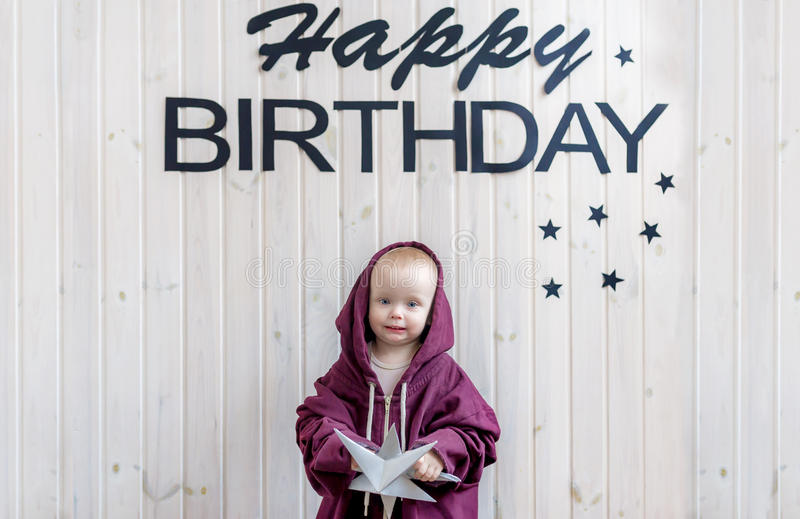 Small child standing in sports suit big size. Birthday of the kid. Small child standing in sports suit big size. Birthday of the kid royalty free stock photography