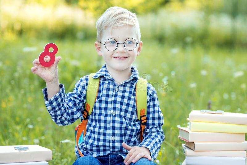 A small child is studying the numbers. Back to school. The concept of learning, school, mind, lifestyle and success royalty free stock image