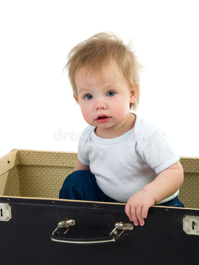 Small child in a suitcase royalty free stock images