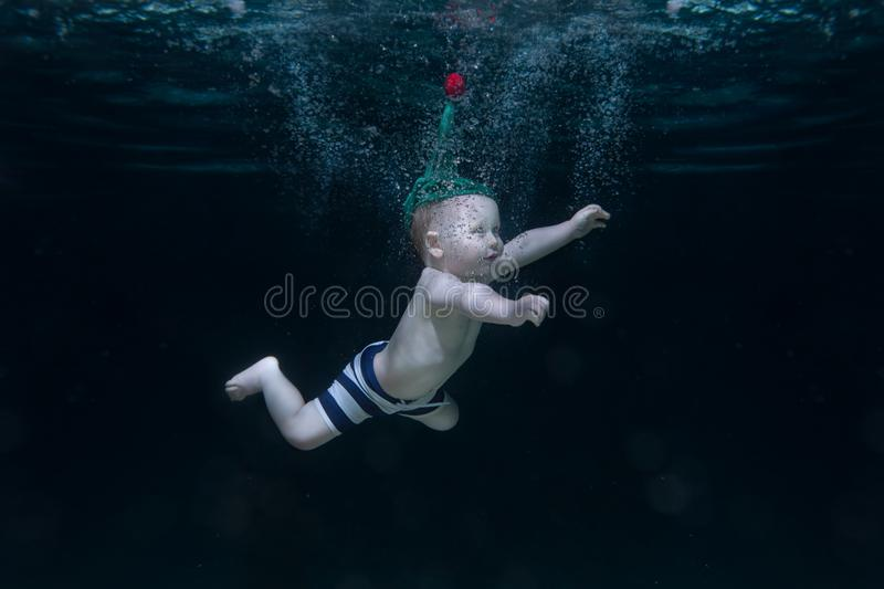 Small child is under water. stock photo