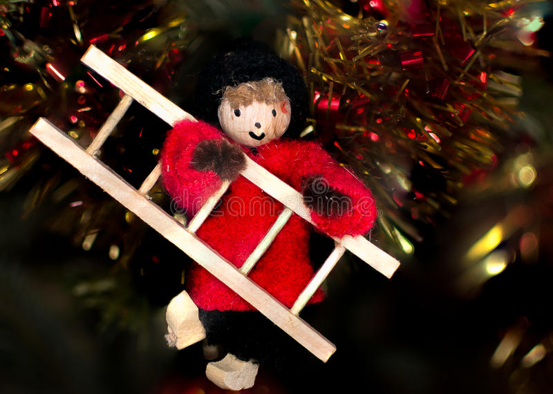 Small chimney sweep in the Christmas tree stock photography