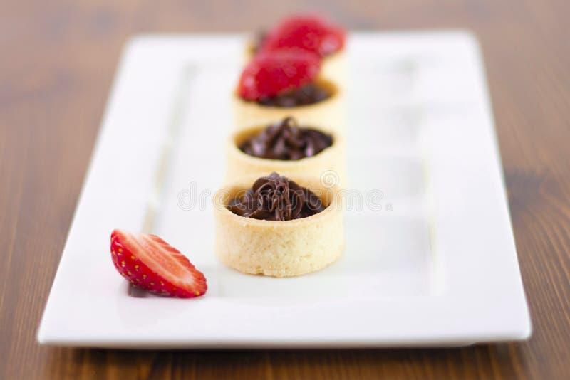 Small chocolate tarts with fresh strawberry stock photo