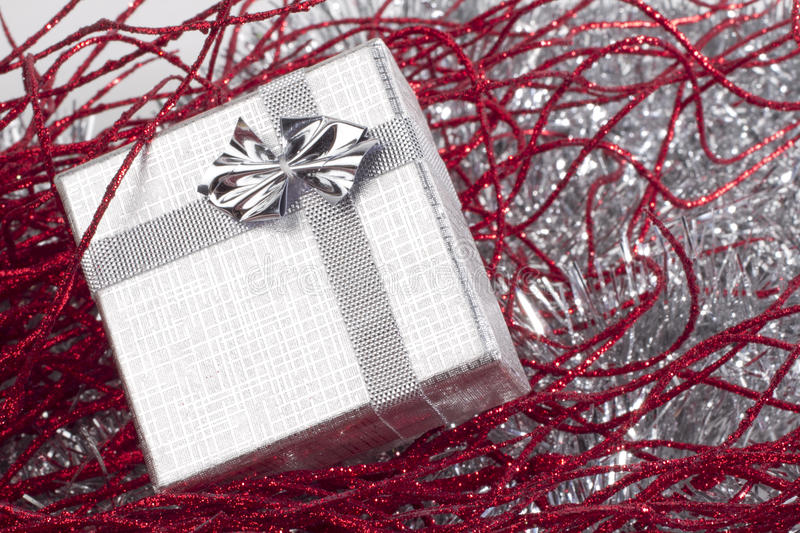 Small christmas gift in red christmas decorations royalty free stock photos