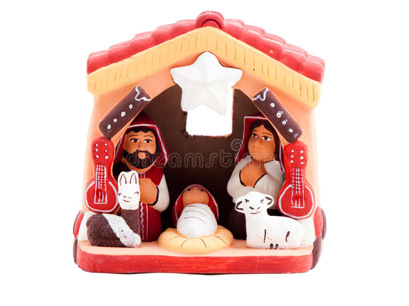 Small christmas manger. Handmade small Christmas manger isolated on a white background. Hand-painted from Peru stock photo