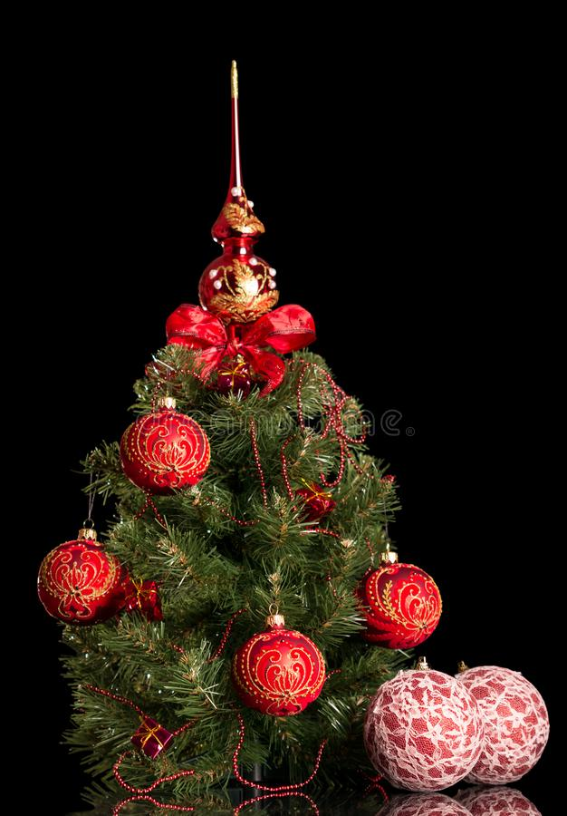 Small Christmas tree decorated with balls and beads with tip, is royalty free stock photos