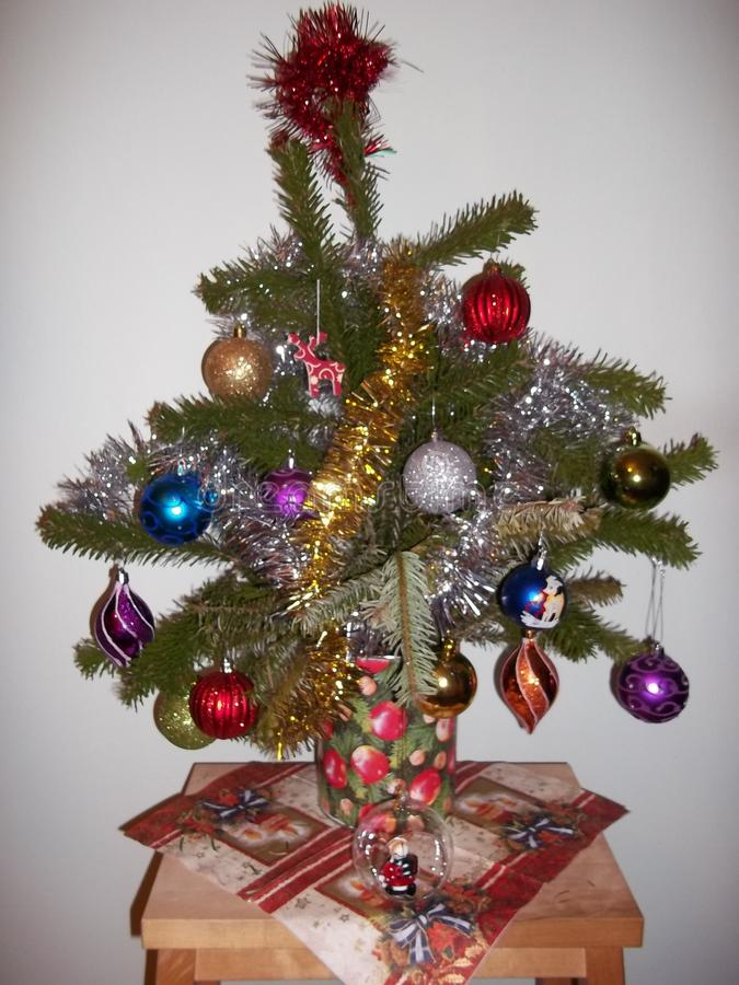 Small christmas tree in a pot with christmas balls royalty free stock photos