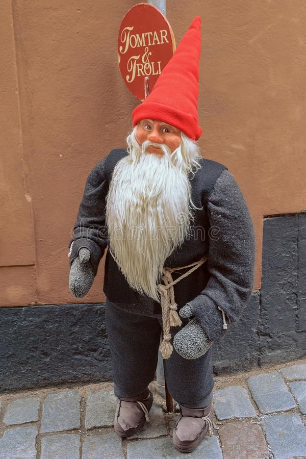 """A small Christmas troll standing on the street in front of a the well known souvenir shop """"Tomtar and Troll"""" stock images"""