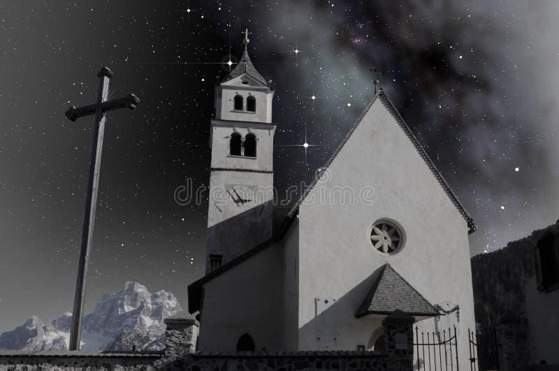 Small church in alpine landscape stock image