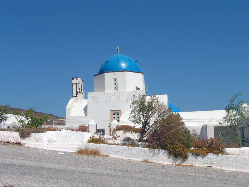 Small church with blue roof at Santorini in Greece royalty free stock photo