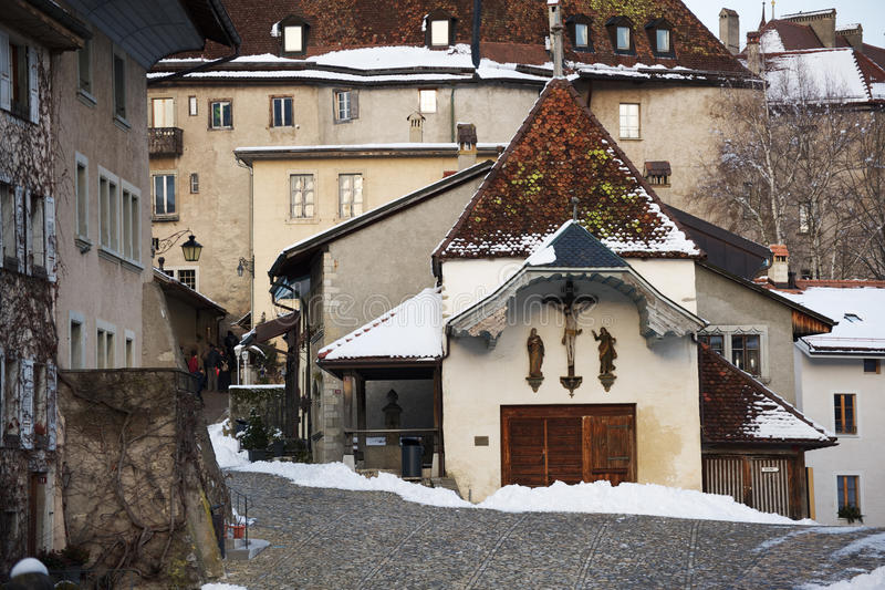 Small church in the Gruyere village in Switzerland. Small church in the Gruyere village in winter, Switzerland royalty free stock photography