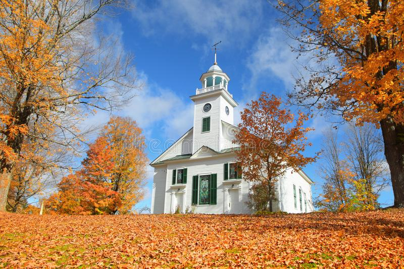 New England town with fall foliage. Small church in typical New England town with fall foliage stock image