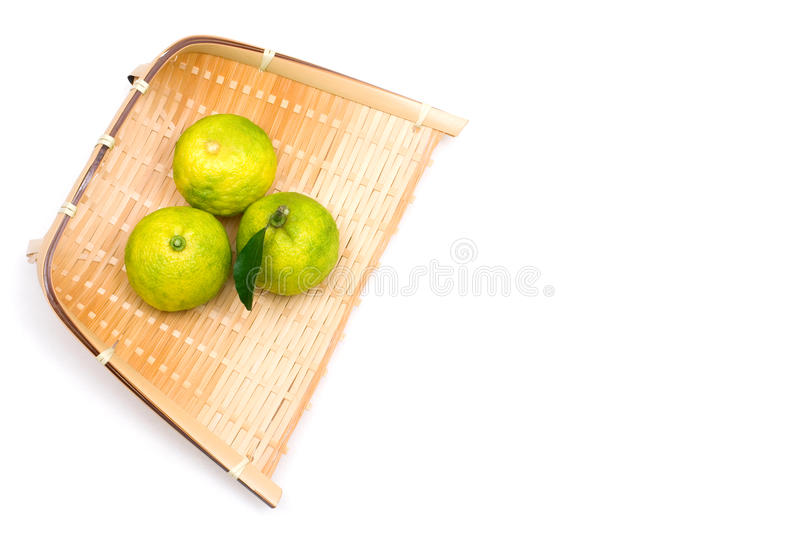 Small citron on the sieve. Japanese small citron named Yuzu stock photography