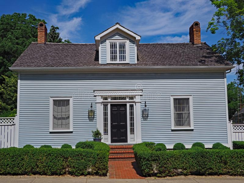 Small clapboard house. With dormer window stock images