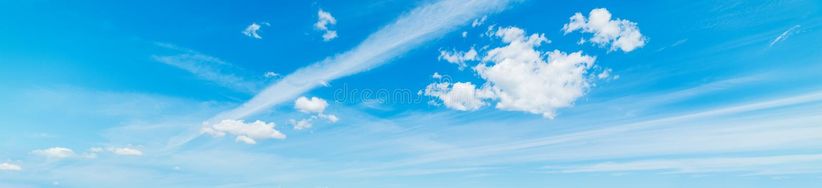 Small clouds and blue sky. Blue sky with white, soft clouds stock photo