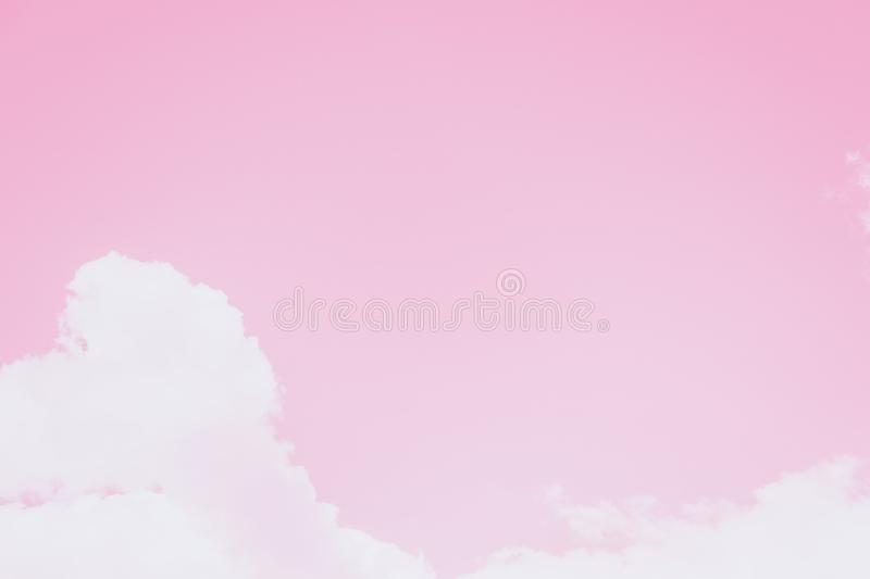 Small clouds on a clear pink sky background. Copy space royalty free stock photos
