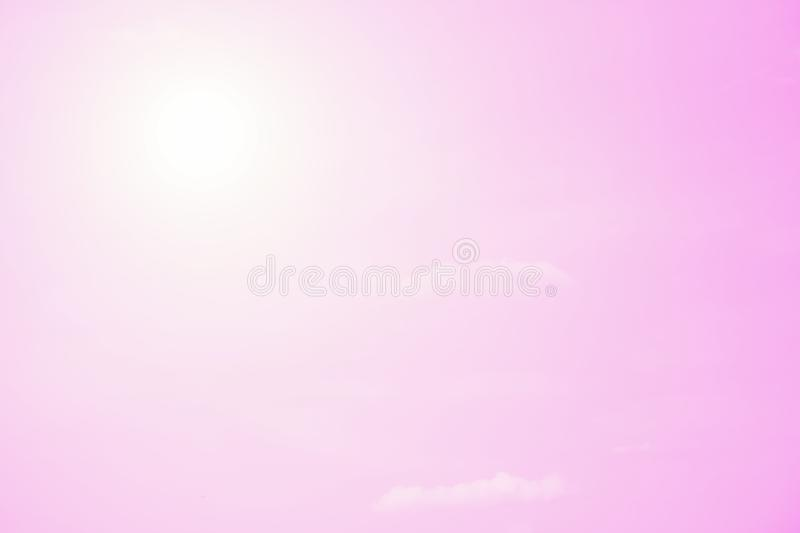 Small clouds on a light gradient pink sky background. Copy space royalty free stock photos