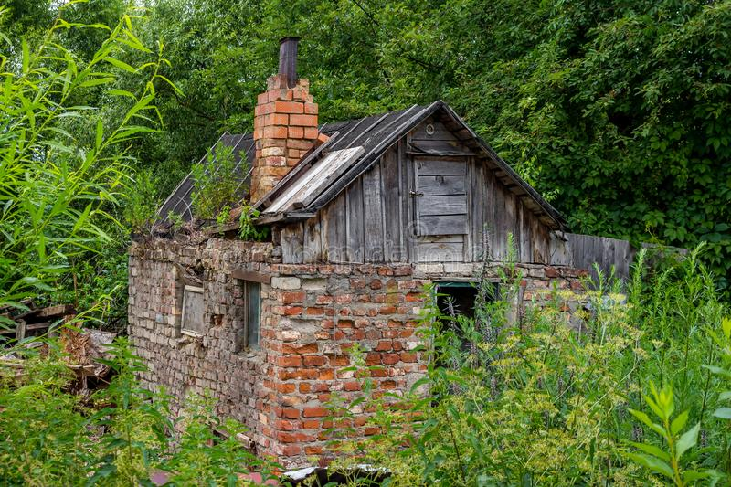 A small clumsy barn of brick, with a chimney stock photography