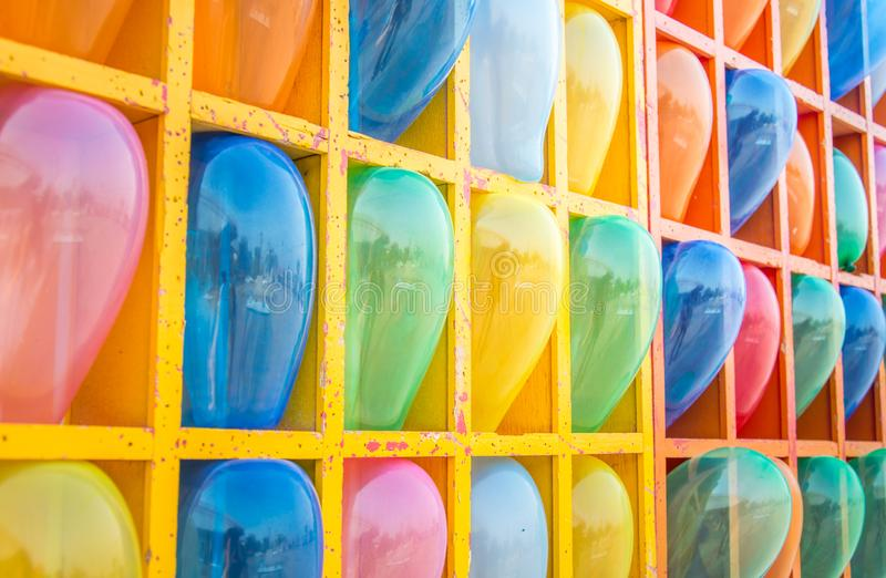 Small colorful balloons in the box royalty free stock image