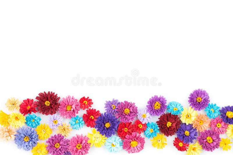 Small, colorful paper flowers made with quilling technique on white background stock photography