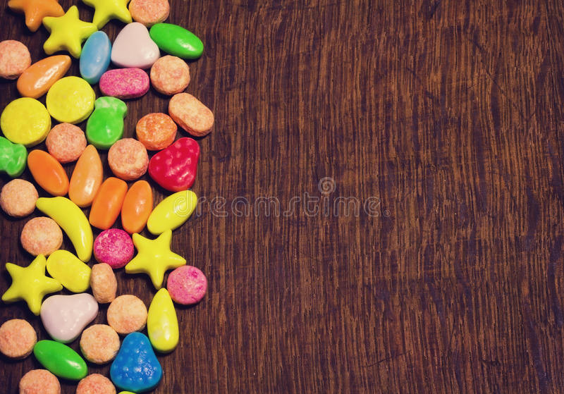 Small colorful sweet candy border stock photo