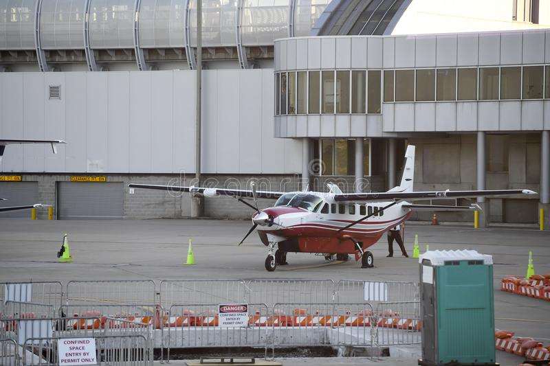 Private prop plane waits beside airport for passengers to arrive royalty free stock photography