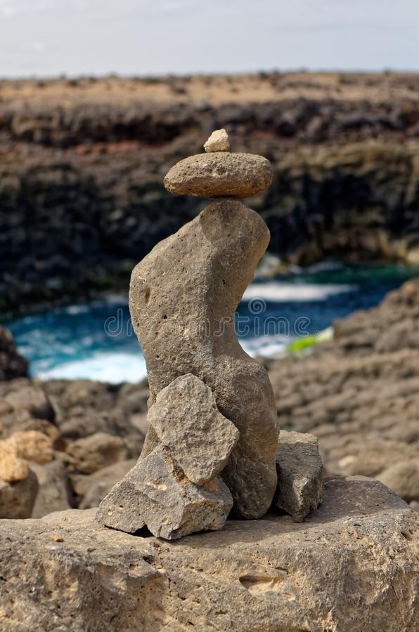 Small composition of stones and a cliff in background. Composition of stones and a cliff in background. Island Sal, Cape Verde royalty free stock images