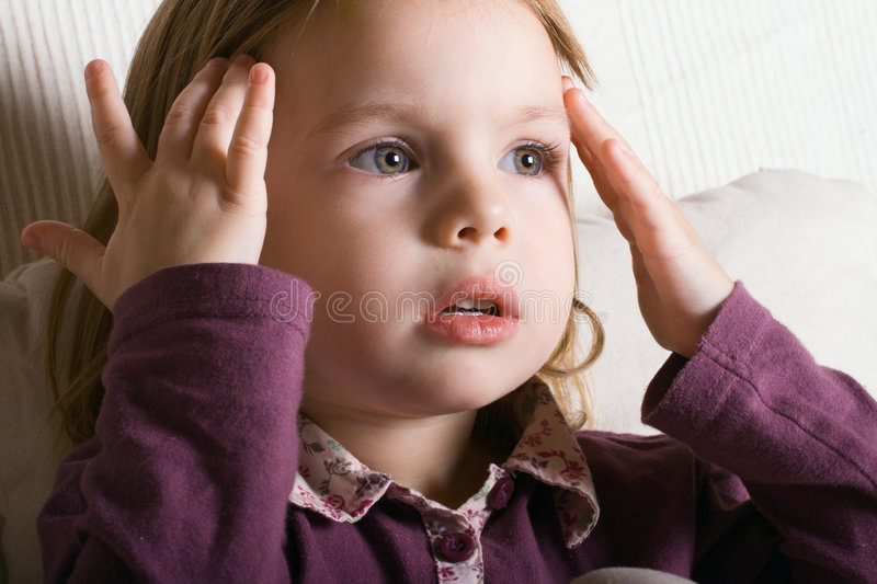 Small concentrated girl. stock photo