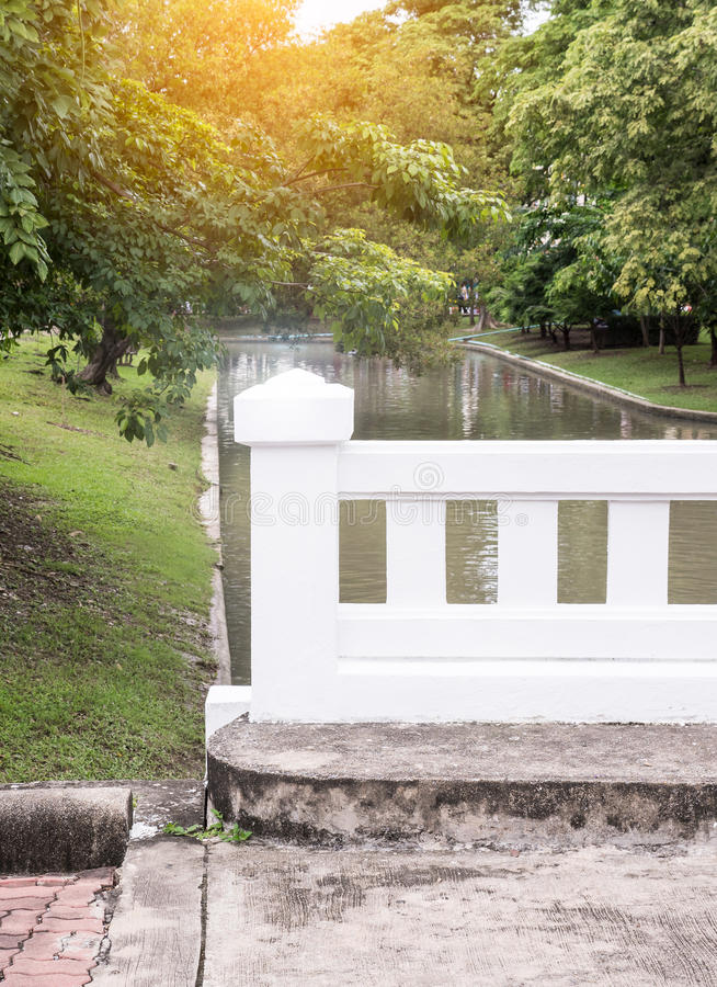 Small concrete bridge with the sunshine. stock images