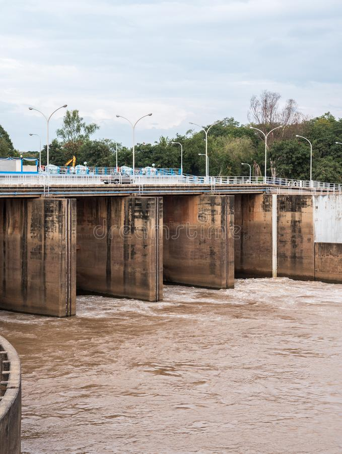 Small concrete dam. Small concrete dam is open the gate for flowing the water in the countryside of Thailand stock photos