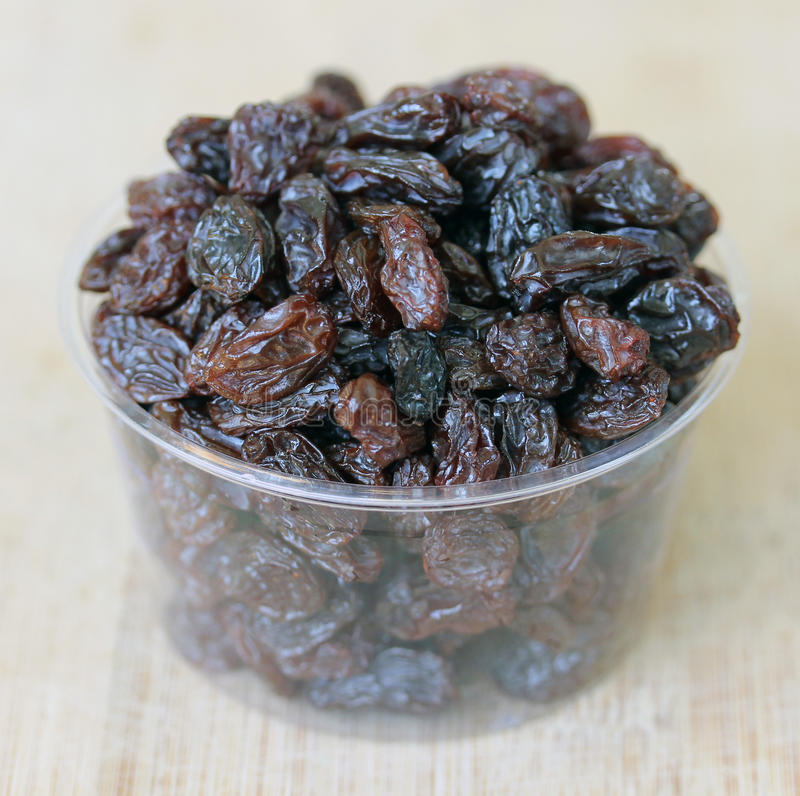 Small Container of Raisins royalty free stock photos