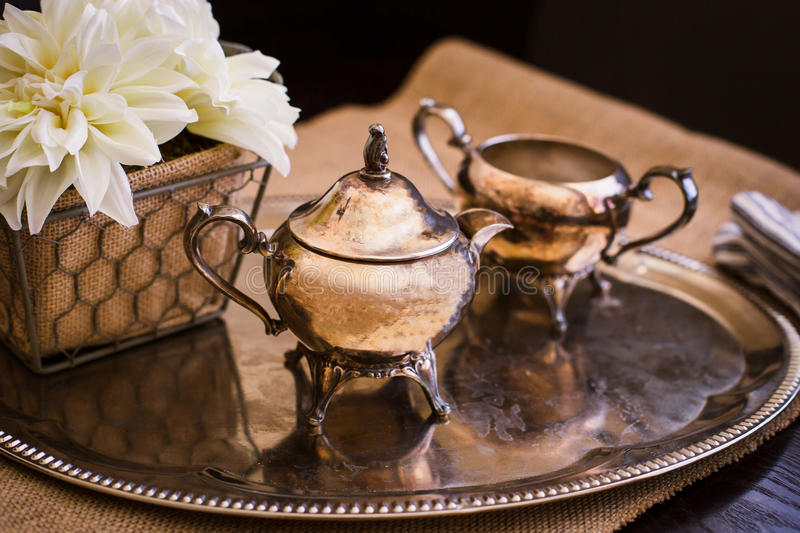 Small Copper Tea Pot on Silver Platter stock photo