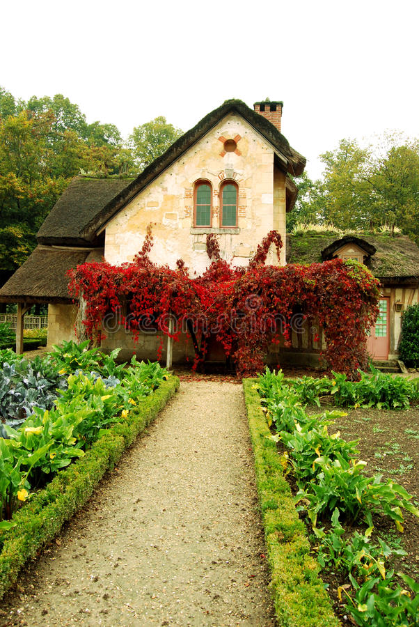 Small cottage and cottage garden in the Queen's hamlet, Versailles, France stock photos
