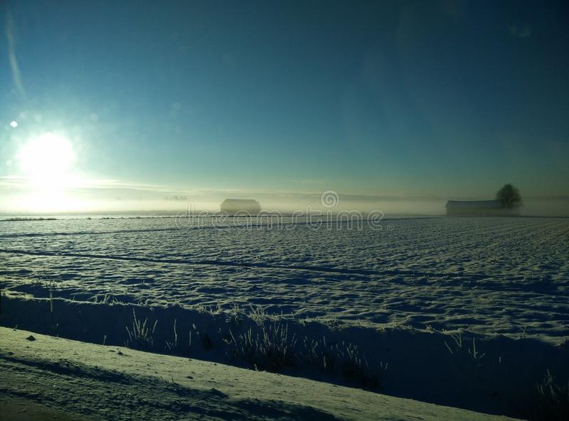Small cottage foggy winter view royalty free stock photography