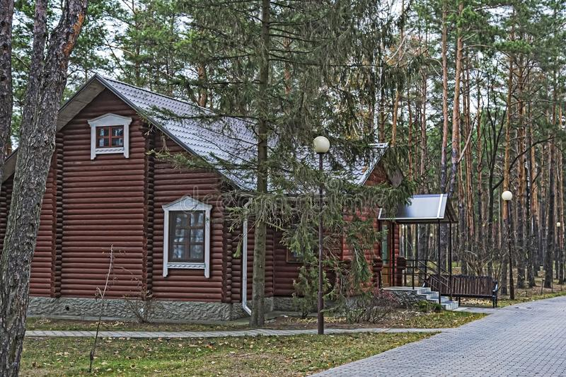 A small cottage in a forested area. royalty free stock images