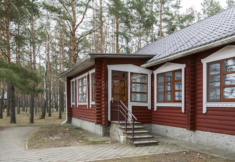 A small cottage in a forested area. stock photography