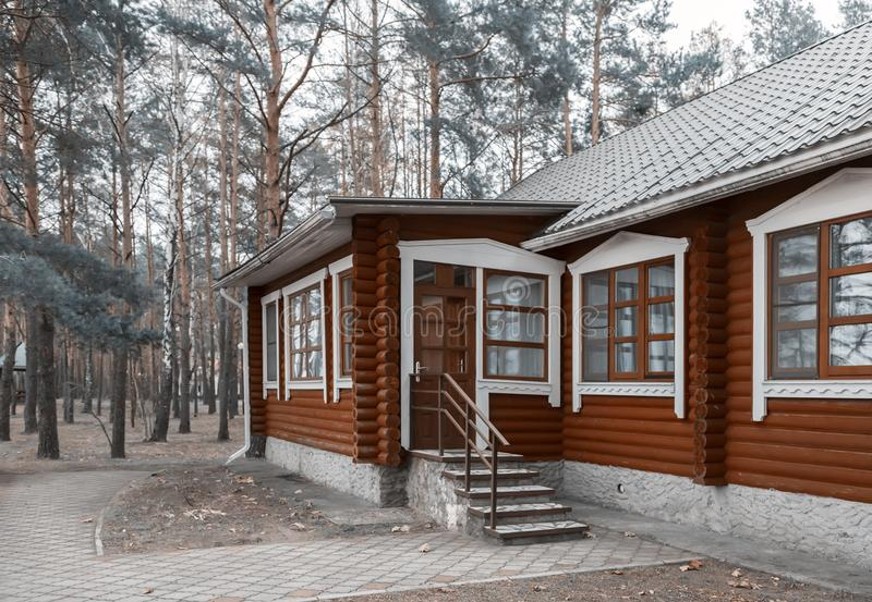 A small cottage in a forested area. royalty free stock image