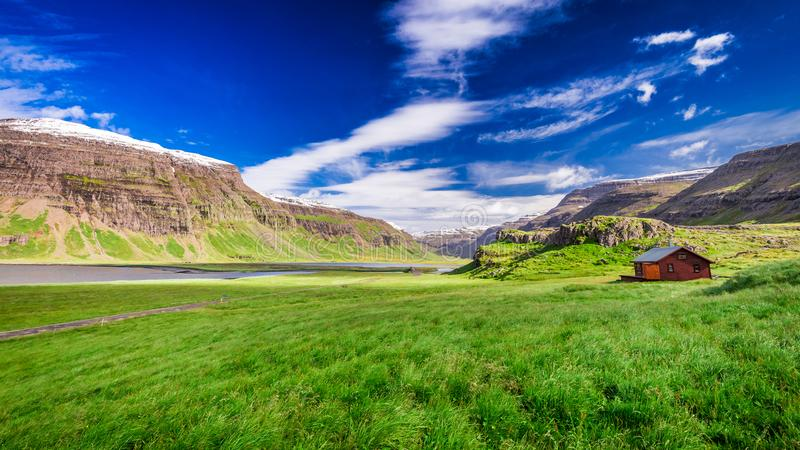Small cottage on green meadow in Iceland royalty free stock photos