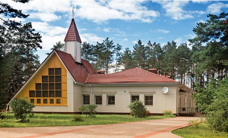 A small cottage of original architectural planning in a forest Park. A small cozy hotel for travelers in a forested area with original architecture stock photo
