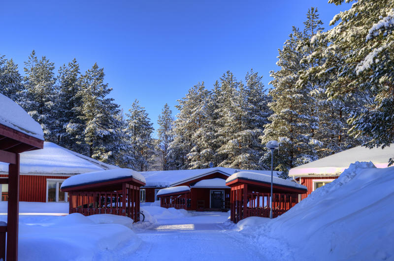 Small cottages in winter landscape stock photo