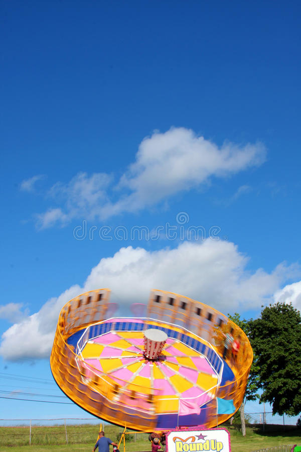 Roundup Ride. Whirling roundup ride spinning at the westville fair in 2014 royalty free stock photography