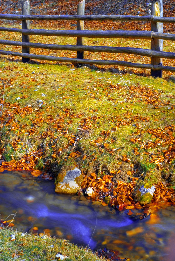 Small country stream and fence royalty free stock photo