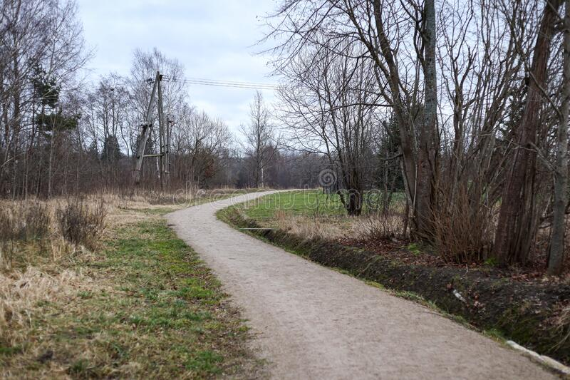 Small countryside walking, hiking tourism path, located in Latvia city Kuldīga. Photo taken on warm winter day in December stock image