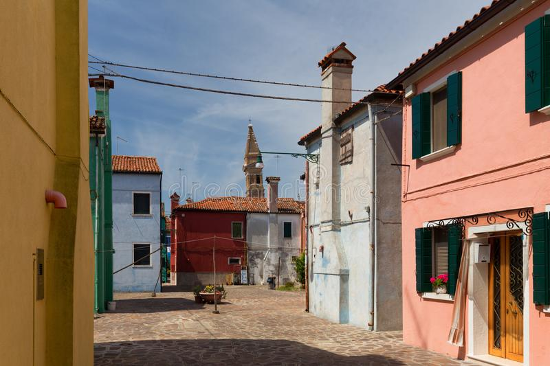 View of the cozy courtyard with colorful cottage / Burano, Venice/ The small yard with bright walls of houses stock photography