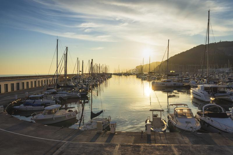 Small and cozy harbor at sunset royalty free stock image