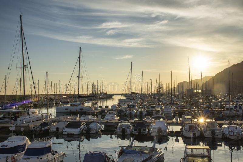 Small and cozy harbor at sunset stock photo