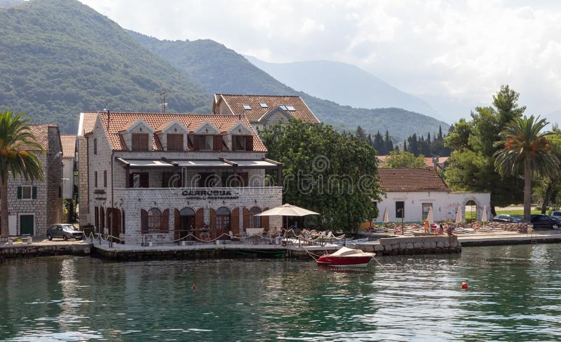 Small cozy hotel and restaurant by the sea on a sunny summer day. DONJA LASTVA, TIVAT, MONTENEGRO, AUGUST 06, 2014: Small cozy hotel and restaurant by the sea on stock image